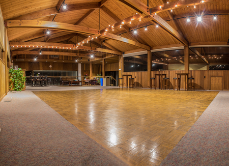 Exquisite wood floor and vaulted ceiling interior of dance hall party room with sparkling lights.  Pierpont Racquet Club of Ventura, California 2018.