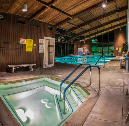 Jacuzzi, therapy pool, and further back, the lap pool of the Pierpont Racquet Club under morning lights in Ventura, California on March 6, 2018 in United States. Stock Photo