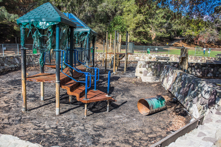 Burnt playground equipment is melted and full of charred ash after the wildfire spread through Ventura.