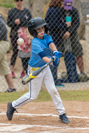All star little league baseball player just misses the pitch and fouls ball up in air. Stock Photo