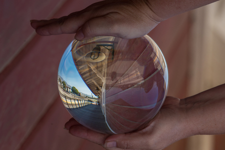 Vintage wooden planks of station platform looking distorted through wide angle lens of crystal ball.