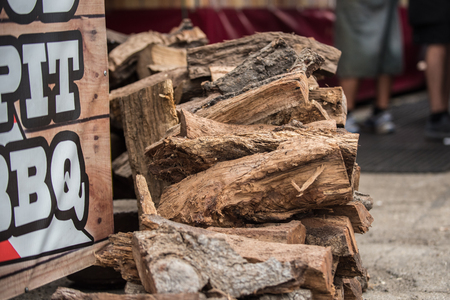 Mesquite wood logs stacked neatly and ready for the smoker grill for bareque flavored meat. Stock Photo