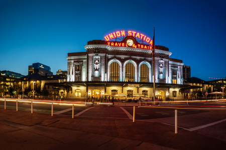 Panoramic view of vintage Union Station transportation center at dusk with streaking lights and bright lamps on August 9, 2018 in Lodo, Denver.