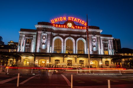 Vintage Union Station transportation center at dusk with streaking lights and bright lamps on August 9, 2018 in Lodo, Denver.