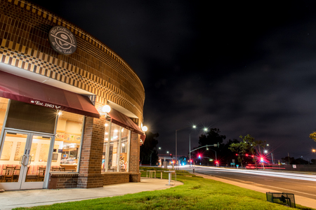 Ominous clouds over the Coffee Bean and Tea Leaf shop on the corner of the busy intersection of Telephone Road and Main Street on August 16, 2018 in Ventura, California. Editorial