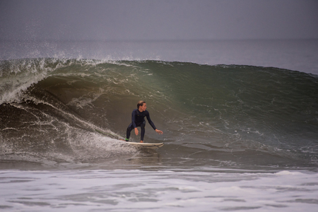 Backside surfer drops in on wave pushed into Ventura by Hurricane Lane at Surfers Knoll Beach in California on August 17, 2018.