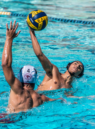 Buena water polo player uses opening in defense to take a shot on goal during game against Foothill High School in Ventura, California on August 28, 2018.