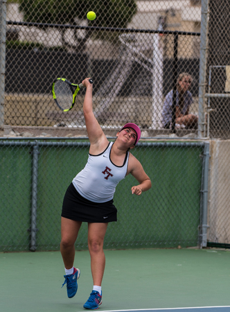High school varsity tennis player from Foothill Tech reaching her racket up for the serve during her match against St Bonaventure on September 4, 2018.