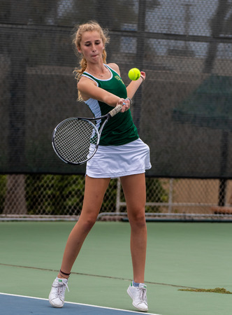 High school varsity tennis player from St Bonaventure focused on hitting a forehand during her match against Foothill Tech on September 4, 2018.