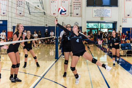 Buena High Schools setter, Kayla Callahan, reaches for the ball during match against Newbury Park during Westlake, California tournament played on August 25, 2018.
