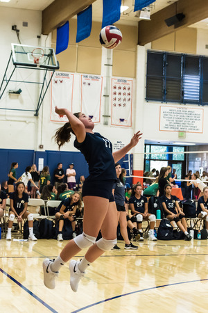 West Ranch High School volleyball pleyer from the freshman-sophomore team jumps high in the air to hit her serve during game of Westlake, California tournament played on August, 25, 2018. Editorial
