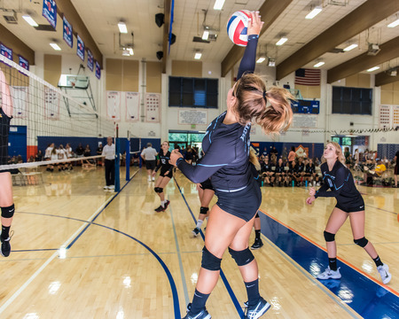 Jessie Gomez of Buena High Schools freshmansophomore volleyball team makes contact on ball from outside position during the Westlake, California tournament played on August 25, 2018.  Madison Morrow and Tyler Gregory also in the frame.