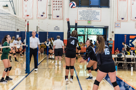 Buena High Schools setter, Kayla Callahan, sets ball to outside hitter, Morgan Pelham, during match against Moorpark during Westlake, California tournament played on August 25, 2018. Editorial