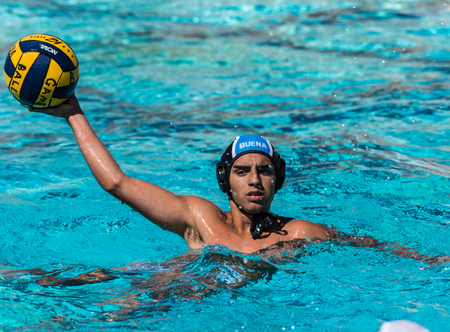 Buena High Schools water polo player hold ball out while looking for a passing lane during game  in Ventura, California on August 28, 2018.