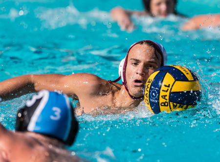 Buena High Schools water polo player keeps eyes on Foothill Technologys defender while moving the ball during game  in Ventura, California on August 28, 2018.