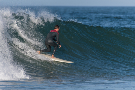 Surfer in full wetsuit drops into sppedy section of wave at Surfers Knoll, Ventura, California on October 1, 2018. Editorial
