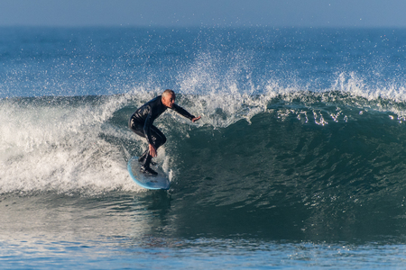 Baby Boomer male surfer dropping into a clean wave pushed by Hurricane Rosa at Venturas Surfers Knoll on September 30, 2018 in California. Editorial