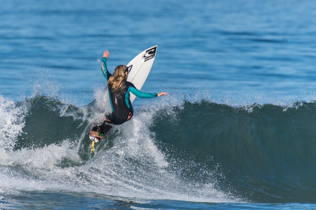 Telented female surfer building speed for a big air on a clean wave pushed by Hurricane Rosa at Venturas Surfers Knoll on September 30, 2018 in California.