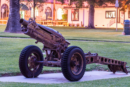 Close up view of M1A1 Pack Howitzer artillery gun on permanent display at Ventura Plaza Park in remberance of past war. Sajtókép