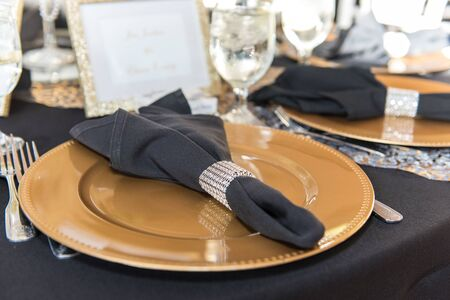 Elegant place settings ready for party guests to arrive and eat the meals.