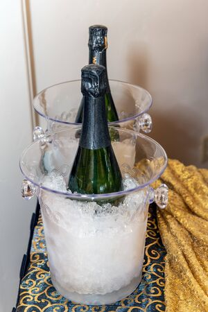 Champange chilled over ice in glass buckets to help liven up the party.