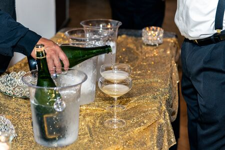 Champange poured into glass flute arranged on table and ready for party goer to drink delicious spirit.. 스톡 콘텐츠