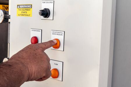 Control panel for high technology machinery has knobs to maintain safe operation by the simple push of a button. 版權商用圖片