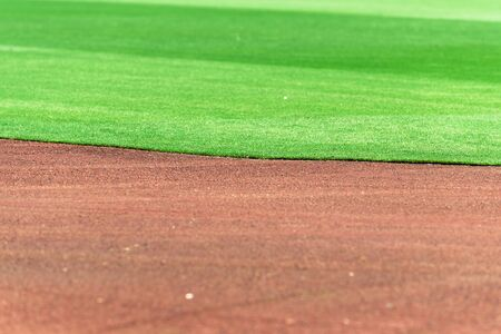 Clean and perfect line between baseball field infield dirt and outfield grass. Stock Photo