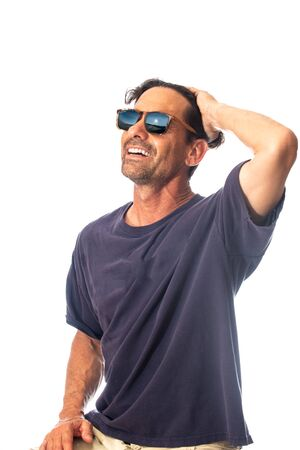 Healthy, masculine, and happy middle aged man smileing while feeling handsome wearing reflective sunglasses in high key background.