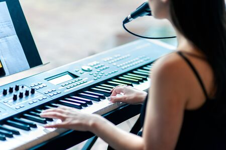 Portable electronic piano with skilled pianist hands and voice can liven up any                                   party.