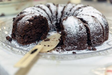 Chocolate bundt cake is more inviting with one of the slices already missing.