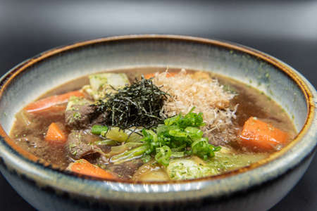 Large and hearty bowl of beef soup topped with seaweed to warm the belly.