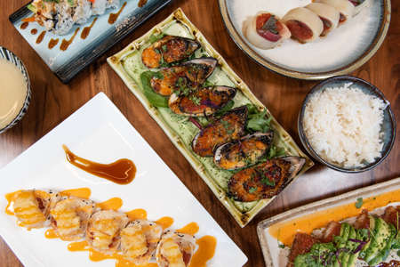Table feast of sushi favorites and appetizers with the always perfect presentation.