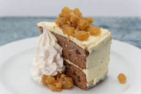 Tasty treat for that sweet tooth with a carrot cake presented with whipped cream.