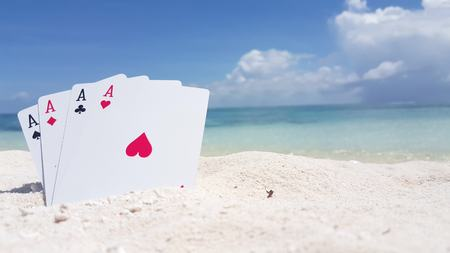 Maldives beautiful beach background white sandy tropical paradise island with blue sky sea water ocean 4k playing cards aces