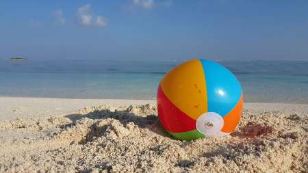 Maldives beautiful beach background white sandy tropical paradise island with blue sky sea water ocean 4k beachball