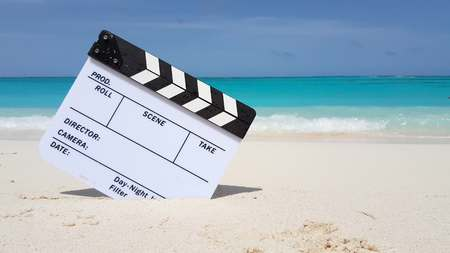Maldives beautiful beach background white sandy tropical paradise island with blue sky sea water ocean 4k clapperboard film slate action cut Stock Photo