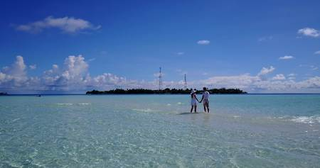 flying kiss: v03933 Aerial flying drone view of Maldives white sandy beach 2 people young couple man woman romantic love on sunny tropical paradise island with aqua blue sky sea water ocean 4k