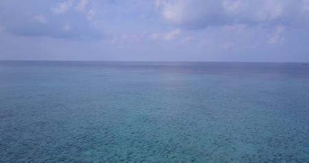 sandbank: Aerial flying drone view of Maldives white sandy beach on sunny tropical paradise island with aqua blue sky sea water ocean Stock Photo