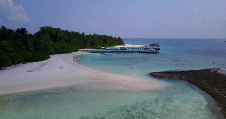 sandbank: v06072 Aerial flying drone view of Maldives white sandy beach on sunny tropical paradise island with aqua blue sky sea water ocean 4k