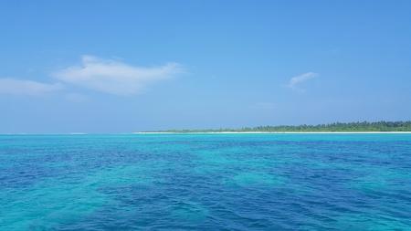 sandbank: P00307 Maldives beautiful white sandy beach background on sunny tropical paradise island with aqua blue sky sea water ocean 4k Stock Photo