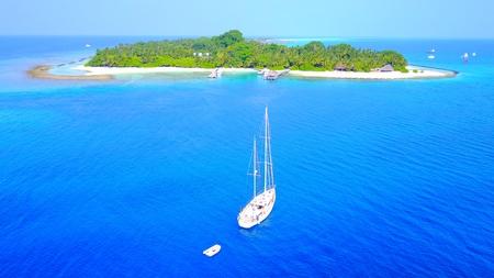 sandbank: P00022 Aerial flying drone view of Maldives white sandy beach on sunny tropical paradise island with aqua blue sky sea water ocean 4k boat sailing