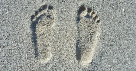 Maldives white sandy beach footprints on sunny tropical paradise island with aqua blue sky sea ocean 4k