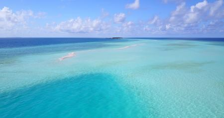 maldives tropical island and blue sea with drone aerial flying view on a beach with white sand and beautiful sky background Zdjęcie Seryjne - 89476841