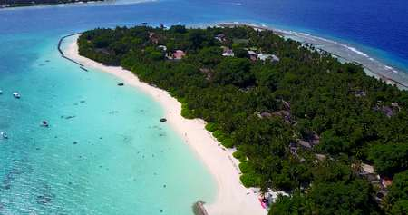 maldives white sand beach tropical islands with drone aerial flying birds eye view with aqua blue sea water and sunny sky