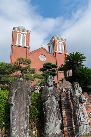 bombed: Atomic bombed christian statues in front of Urakami Cathedral in Nagasaki, Japan