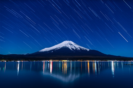 Nightview of Mount Fuji with startrails from Lake Yamanaka in winter.