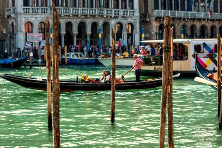 grand canal: Gondola with passengers on the Grand Canal Stock Photo