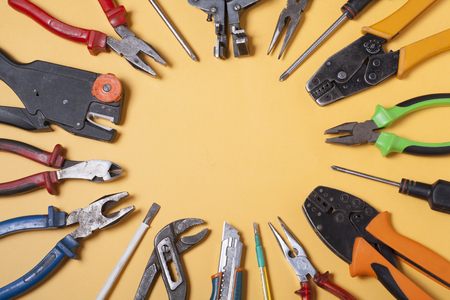 electrical energy: Set of electrical tool on wooden background. Accessories for engineering work, energy concept