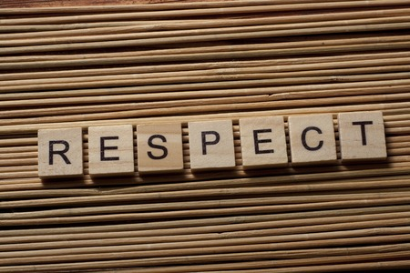 respectable: RESPECT word written on wood block on wooden background. Stock Photo